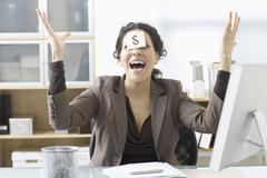 Businesswoman Sitting at Desk with Self Adhesive Note on Forehead Stock Photos