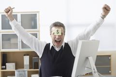 Businessman Sitting at Desk with Self Adhesive Note on Forehead Stock Photos