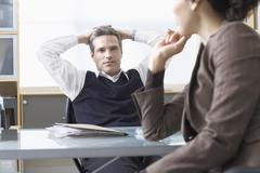 Business People Talking at Desk Stock Photos