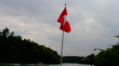Swiss flag flying at the boat floating on  Rhine Stock Footage