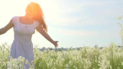 Girl with bunch of wild flowers having fun outdoor - stock footage