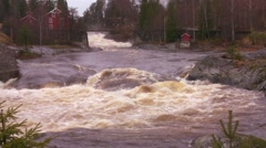 A river reaches massive flood stage in Norway. - stock footage
