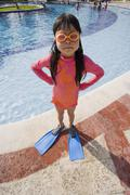 Girl With Hands on Hips Next to Swimming Pool Stock Photos