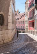 Old narrow street in lisbon Stock Photos