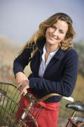 Portrait of Woman With Bike, Stinson Beach, Marin County, California, USA - stock photo