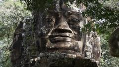 Giant Stone Faces at Angkor, Siem Reap, Cambodia Stock Footage