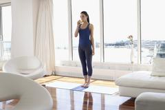 Stock Photo of Woman Practicing Yoga in Condominium