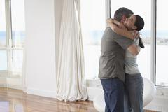Stock Photo of Couple Hugging in Condominium