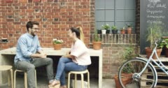 Couple dating drinking coffee in cafe Stock Footage