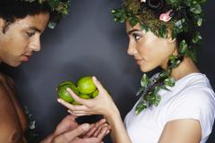 Couple With Wreaths in Hair, Holding Limes - stock photo