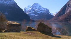 A beautiful shot of a peaceful fjord in Norway with boulders foreground. - stock footage