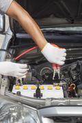 Mechanic working in auto repair shop. Stock Photos