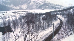 A train travels through a snowy landscape in Europe. Stock Footage