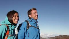Hiking - Hikers talking on mountain top Stock Footage