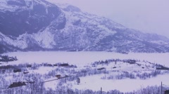 A train travels through a snowy landscape in Europe. - stock footage