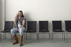Redneck in Waiting Area - stock photo