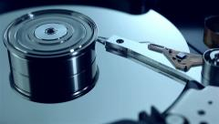 Dolly shot of Hard disk drive with spinning platter - stock footage