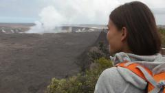 Stock Video Footage of Hawaii - Hiking woman looking at Hawaiian volcano