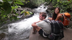 Hiking couple hikers in outdoor activity on Hawaii Stock Footage