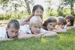 Group Portrait of Kids Lying Down Outdoors, Elmvale, Ontario, Canada Stock Photos