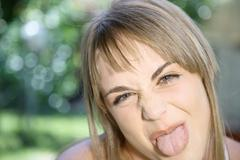 Teenaged Girl Sticking Out Her Tongue - stock photo
