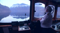 POV of a ferry boat with captain at the helm as it sails through mysterious fog Stock Footage