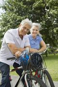 Baby-Boomer Couple Riding Bikes Stock Photos