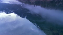Panning shot along the water of a fjord in fog in Norway. Stock Footage