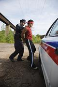 Police Officer Arresting Suspect - stock photo