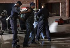 Police Officers Arresting Suspects Stock Photos