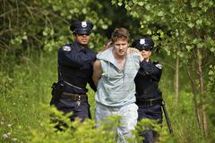 Police Officers Arresting Suspect - stock photo