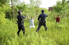 Police Officers Arresting Suspects - stock photo