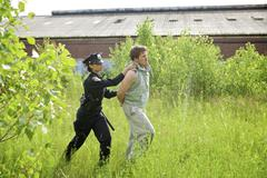 Police Officer Arresting Suspect Stock Photos