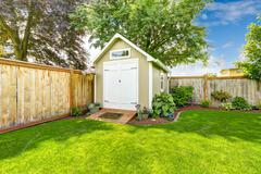 Fenced backyard with small shed Stock Photos