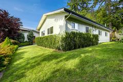 house with curb appeal. - stock photo