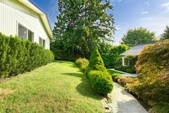 House with curb appel. front yard landscape Stock Photos