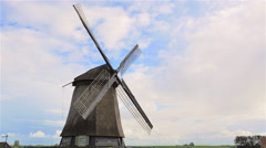 4K traditional Holland windmill rotating against blue idyllic sky Stock Footage