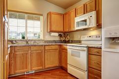 small kitchen area with white appliances - stock photo