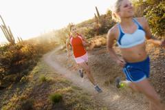 Women Running on Desert Trail, Saguaro National Park, Arizona, USA Stock Photos