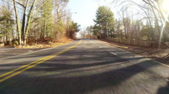 Driving Down Narrow Two Lane Road Stock Footage