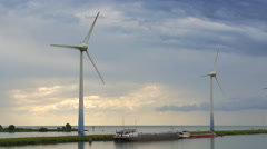 4K turbine towers rotating against cloudy sky Stock Footage