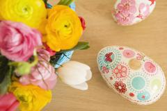 Easter Eggs and Vase of Flowers - stock photo