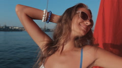 Beautiful girl in a white bikini with rhinestones enjoying life, smiling on a Stock Footage