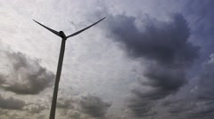 Windturbine on cloudy day - stock footage