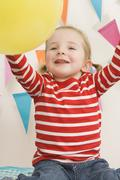 Little Girl Playing With a Balloon at a Birthday Party Stock Photos