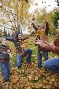 Family Throwing Autumn Leaves in the Air, Portland, Oregon, USA Stock Photos