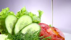 Healthy vegetable salad with olive oil dressing - stock footage