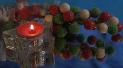 Red Christmas tea candle with berries Stock Footage