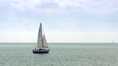 4K serene seascape with yacht sailing Stock Footage