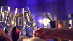 Glasses with Sparkling Champagne over Holiday Bokeh Blinking Background - stock footage